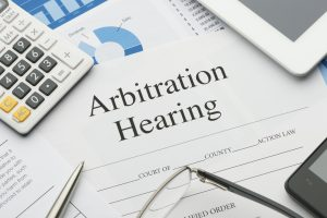 Arbitration hearing form on a desk with paperwork